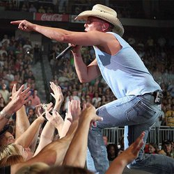 Music Friday: Brokenhearted Kenny Chesney Wears His Ring on a Chain in 1999's 'I Might Get Over You'